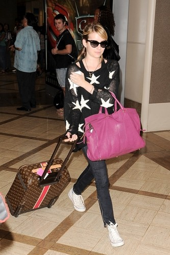 Emma Roberts Lands With Custom Luggage